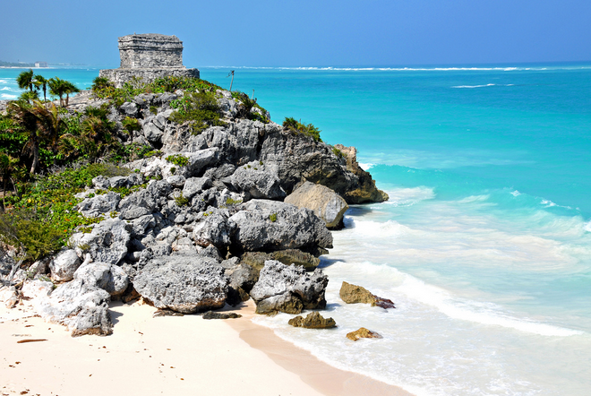 stone ruins on a cliff overlooking the caribbean ocean