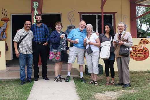 Self-Sufficiency Seminar attendees (with horticultural expert Thomas Barker, second from left) gathered outside the French bakery at San Ignacio's farmer's market. Photo courtesy of Andre Fortier