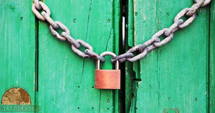 A lock on a wooden door. | Creating An Asset Protection Plan