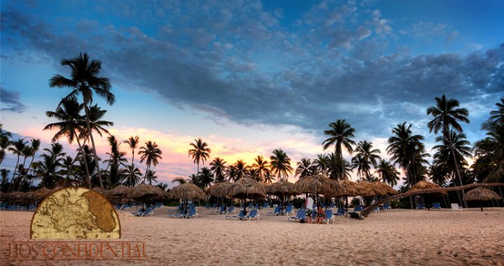 The sun sets over the Dominican Republic while walking on the beach in Bavaro, near Punta Cana.