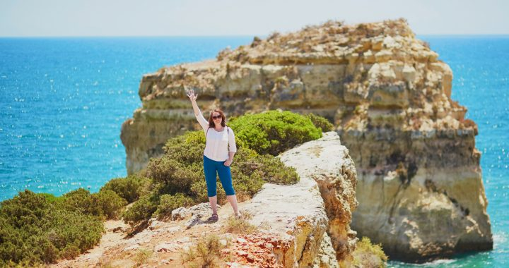 Tourist enjoying scenic landscape in Algarve, Portugal