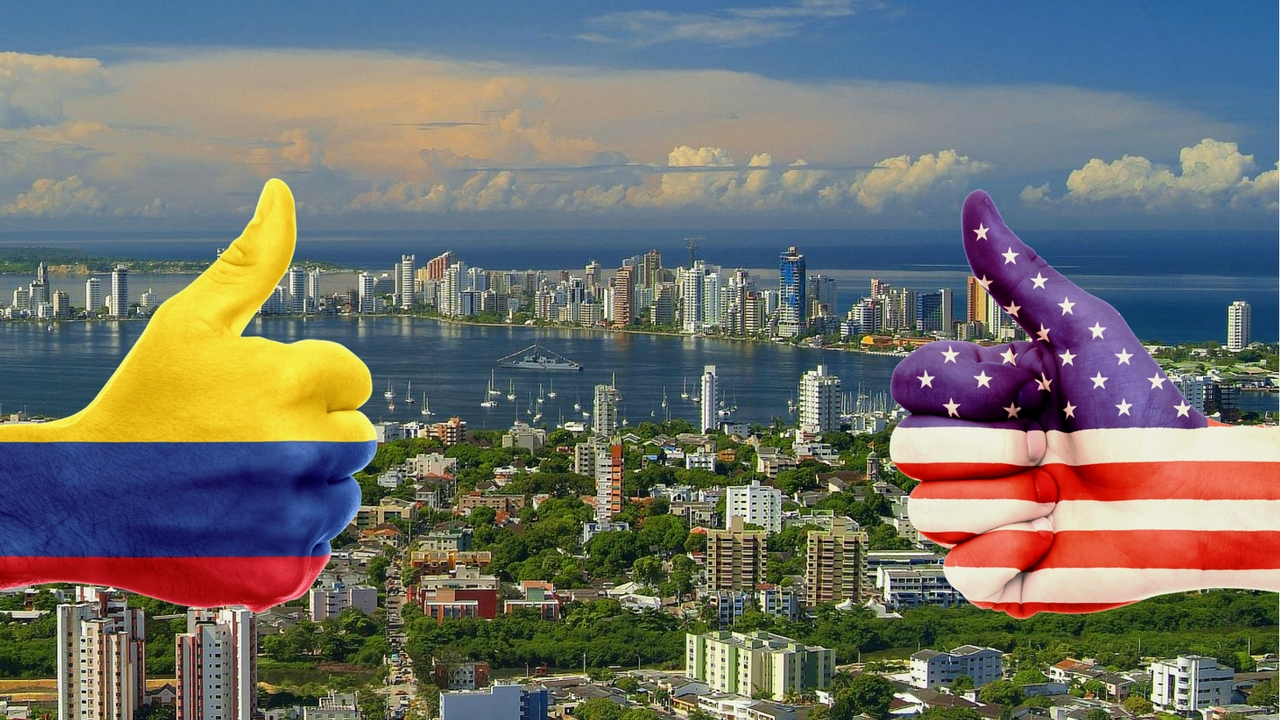 thumbs up one hand in colombia colors one hand in U.S. colors
