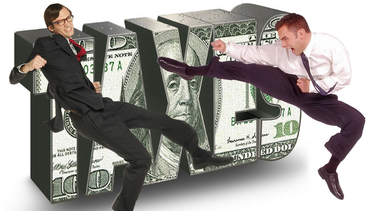 A guy karate kicking a man dressed up like an IRS agent with the word taxes in the background over a US$100 bill
