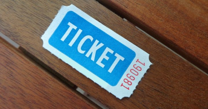 old style ticket on a wooden table