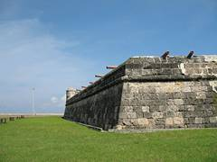battlements with stone wall and cannons at cartagenas walled city