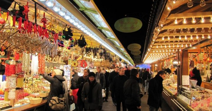 shoppers enjoying the christmas market in france