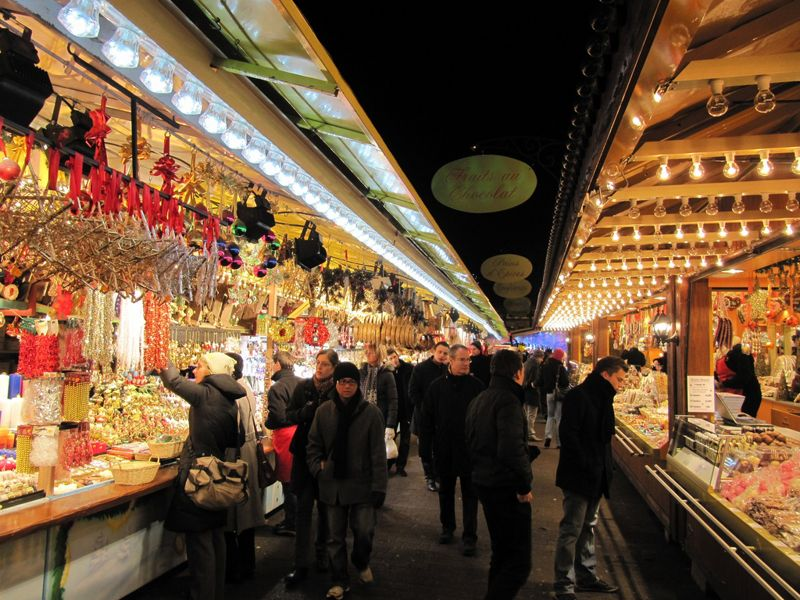 shoppers enjoying the christmas market in france