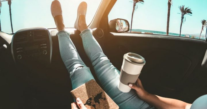 A relaxed traveller in a car