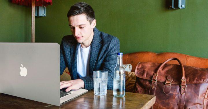 Digital nomad working at laptop