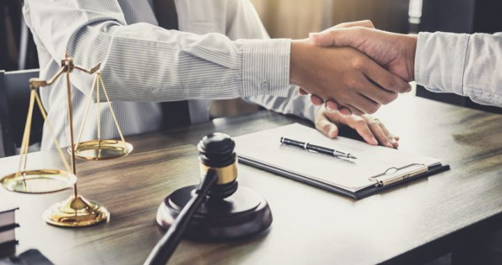 A lawyer shaking hands with a client