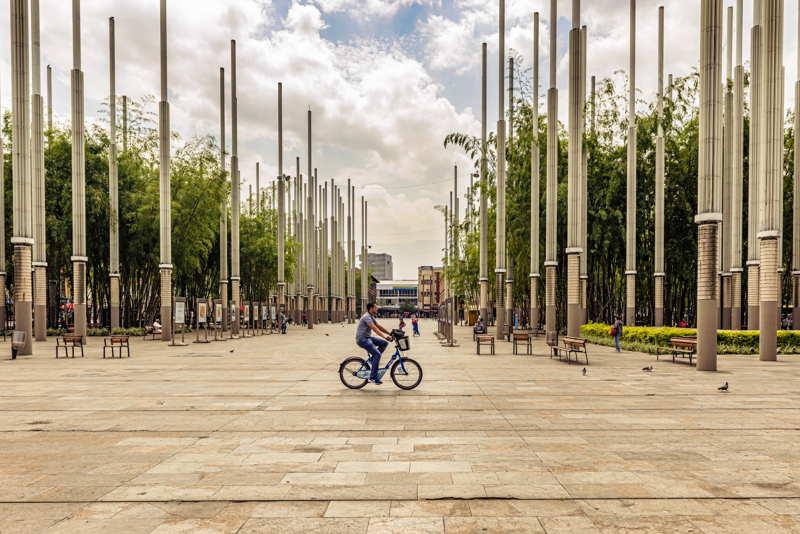 parc de las luces medellin person on a bike