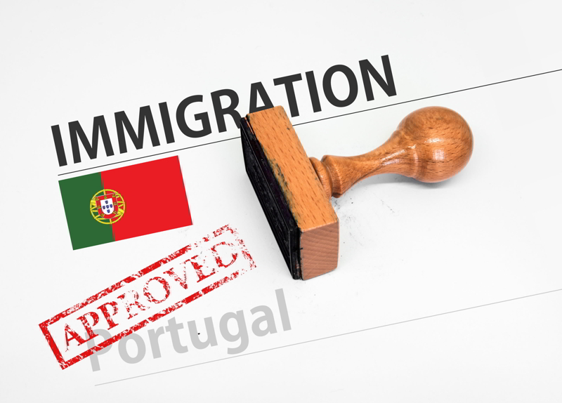 Approved Immigration Portugal application form with rubber stamp.
