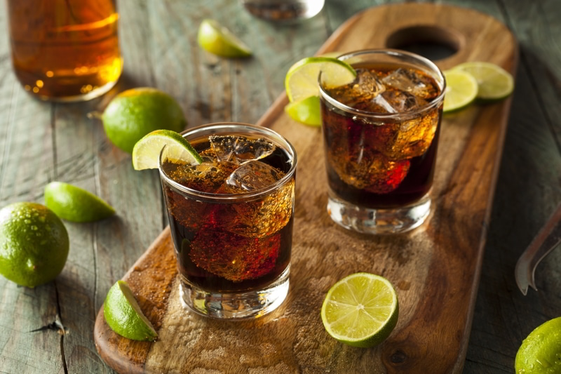 Rum and coke with lime and ice.