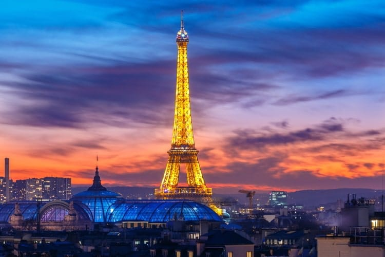 Shimmering Eiffel Tower at sunset in Paris, France.