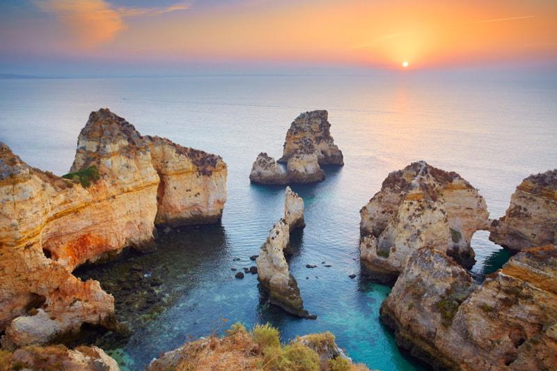 Sunrise at Algarve coast near Lagos, Portugal.