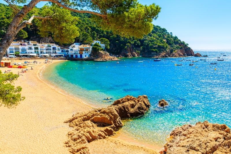 Amazing sandy beach in Tamariu seaside town, Costa Brava, Spain.