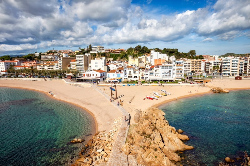 Beach and townscape of Blanes, coastal resort town on Costa Brava in Catalonia, Spain.
